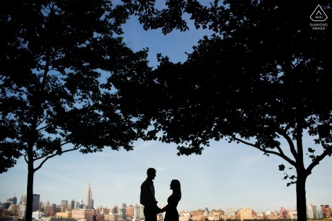 Couple engagement portrait along new york city skyline