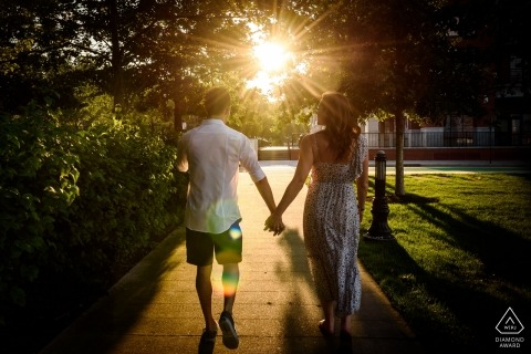 NJ pictures of a couple walking into the sunlight | wedding engagement photographer