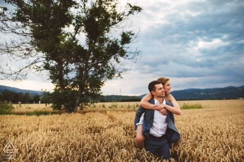 Slovenia pre-wedding engagement shoot in grass wheat field