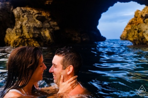 Valencia wedding engagement portrait of a couple swimming in the water | Alicante pre-wedding photographer session