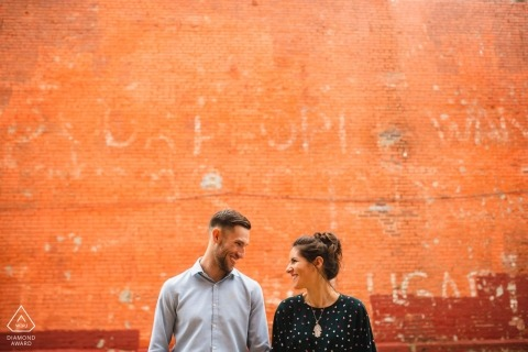The Orange wall wedding engagement portrait of a couple | DC pre-wedding pictures