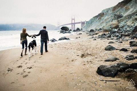 Engagement Portraits in San Francisco on the beach by the bridge