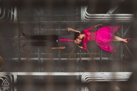 Ljubljana wedding engagement photography with a couple, shot from above with a bright pink dress and tie | Slovenia photography