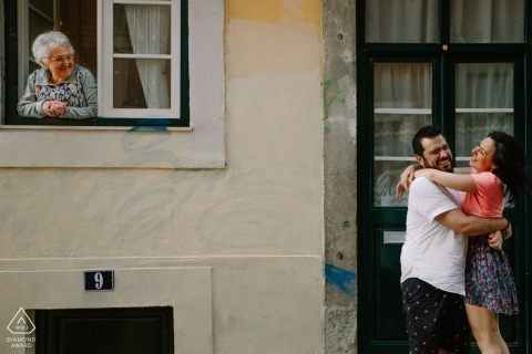 Brazil wedding engagement shoot with a couple with window watchers | Portugal pre-wedding photographer session