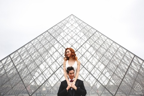 wedding engagement shoot with a couple and a glass structure   Paris pre-wedding photographer session