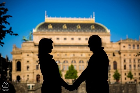 Prague engagement pictures of a couple silhouetted with buildings in background | Czech Republic photographer pre-wedding photo shoot session