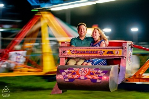A couple rides the Scrambler during a Virginia Fair Engagement Photography session