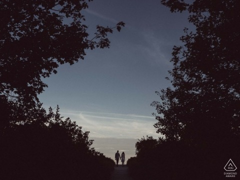 Portland Maine Engagement Photo of a couple near dusk with big sky and big trees