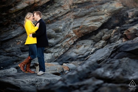 RI pre-wedding engagement pictures of a couple on the rocks at the beach  | New England portrait shoot
