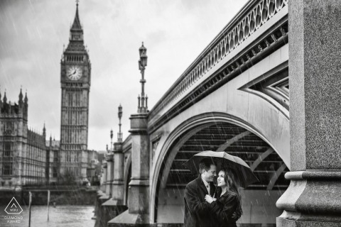 Hérault black and white wedding photographer engagement portrait of a couple with Big Ben | Occitanie pre-wedding pictures