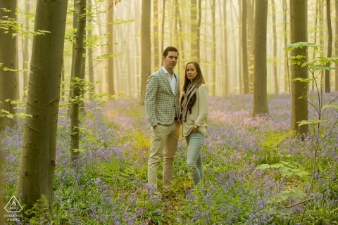 Netherlands engagement photos of a couple in the green forest  | Netherlands photographer pre-wedding portrait session
