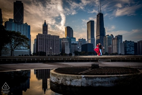 Chicago engagement photos of a couple with the city skyline behind    IL photographer pre-wedding portrait session