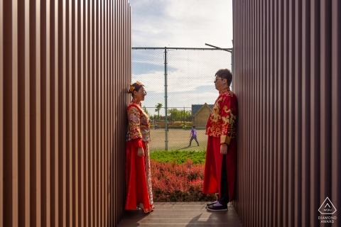 China engagement images of a couple in red traditional wear | Liaoning photographer pre-wedding session for portraits