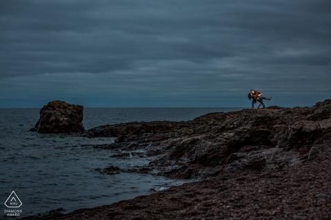 Engaged couple take a romantic dip by lake | MN pre-wedding portraits