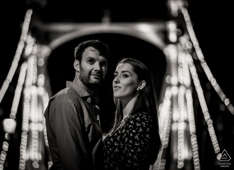Dorset pre-wedding engagement pictures of a couple at night with lit bridge  | couple photography session