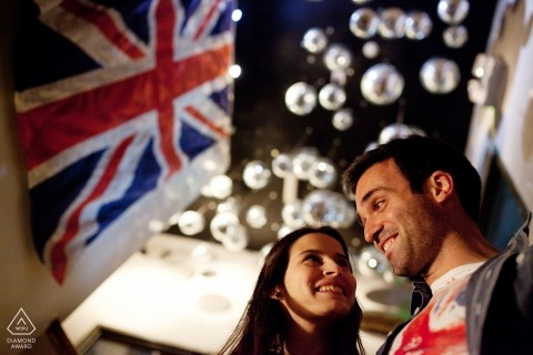 Braga engagement photos of a couple with flags and lights | Portugal photographer pre-wedding portrait session