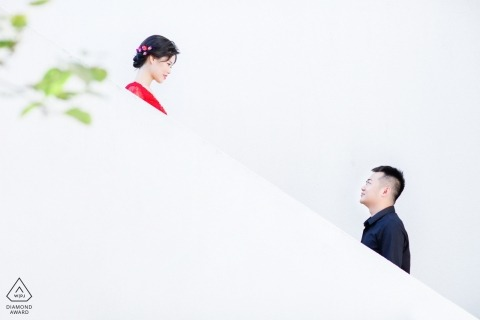 China engagement photos of a couple on white stairs | Fujian photographer pre-wedding portrait session
