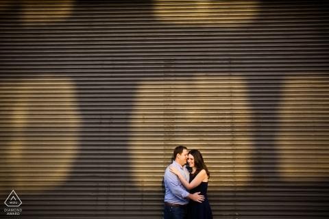 Sunlit engagement photos of a couple embraced | Rhode Island photographer pre-wedding portrait session