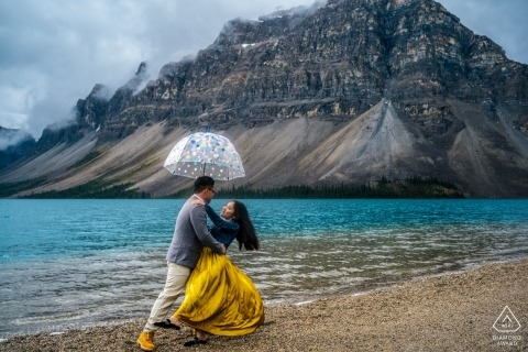 An Alberta couple at the water's edge during their pre-wedding portrait session Canada photographer