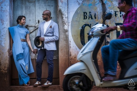 Goa couple shoot for engagement portraits with moped scooter passing by