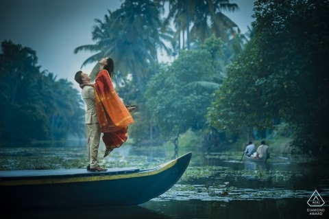 Kerala backwater wedding engagement portriat of a couple in a boat on the water