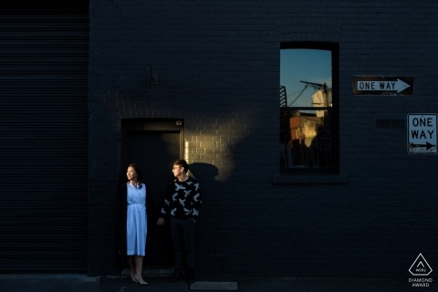 Australia wedding engagement portrait of a couple with 'One Way' street signs  | Melbourne pre-wedding photographer session