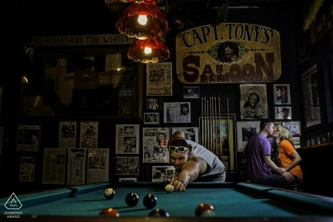 Florida wedding engagement portrait of a couple in pool hall | Key West pre-wedding photographer session