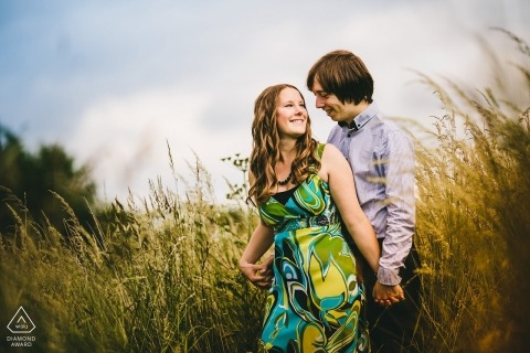 Northamptonshire wedding engagement portrait of a couple in tall grass | East Midlands pre-wedding photographer session