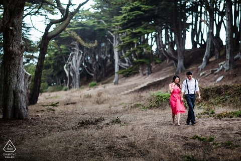 A San Francisco engaged couple stroll for their pre-wedding photo session for California engagement photographer