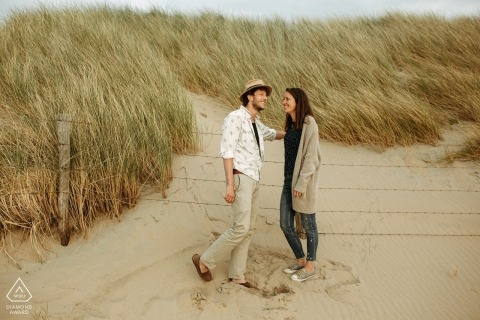 Engagement photo session for a couple on the sandy beach near Utrecht.