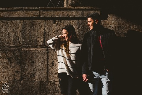 Engagement session for a couple in Siena with warm light outside