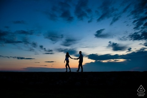 Engaged couple out for a sunrise stroll in Rye | NH engagement and wedding photographer