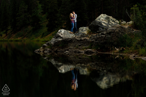 A couple is reflected in the water during their engagement photos at Officer's Gulch near Copper Mountain Colorado