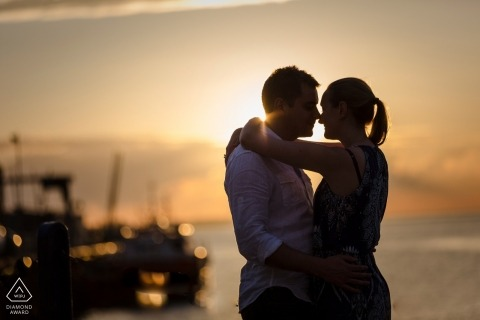 England pre-wedding engagement pictures of a couple embracing at the beach with boats | Kent portrait shoot