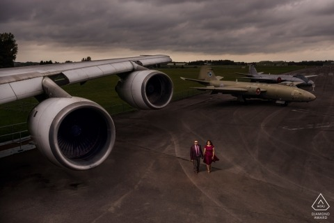 A London couple during their airport pre-wedding portrait photo shoot by an England photographer