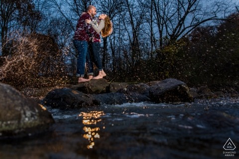 A Minneapolis couple near the water during their pre-wedding portrait session by a Minnesota photographer
