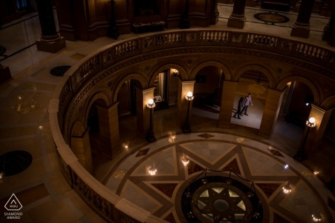Engaged couple walking in the capital building in MN during their engagement photography session.