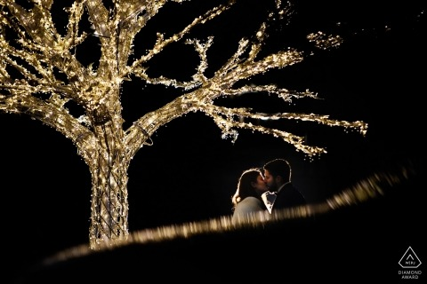 Bucharest destination wedding photography | Romania engagement session with trees and lights at night