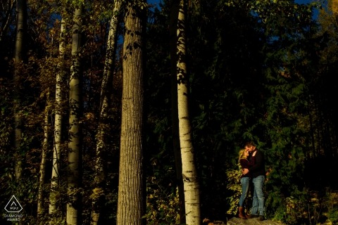 Engaged couple pose for portraits in the autumn forest | Nelson BC Wedding Photographer