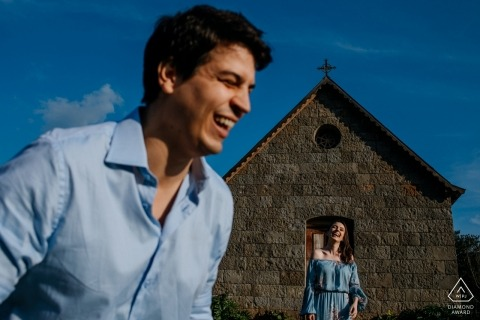 Rio Grande do Sul pictures of a couple before a stone church by a top Brazil wedding engagement photographer