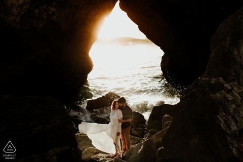 A Rio Grande do Sul couple during their pre-wedding beach portrait session by a Brazil photographer