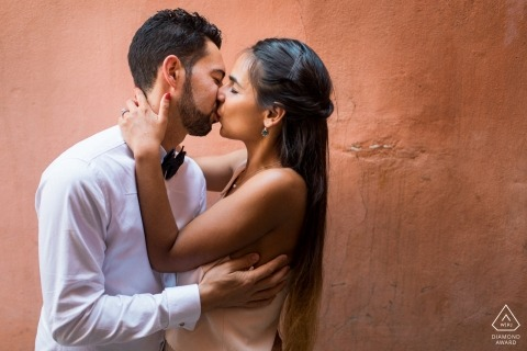 Portrait of engaged couple kissing | French Wedding Photographer in Morocco