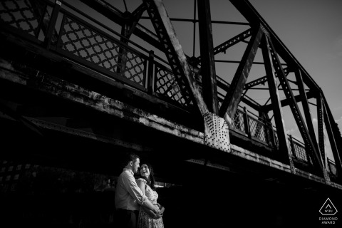 Denver, CO couple celebrates their engagement with a bridge portrait session