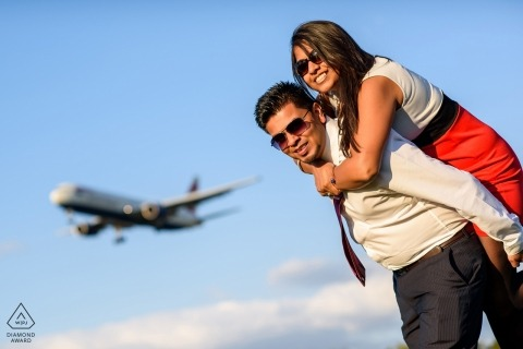 England Heathrow Bedfordshire Engagement Photograph with couple at airport with airplane
