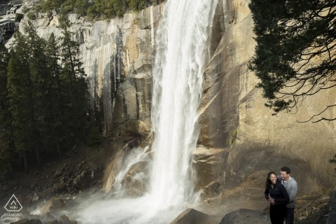 yosemite falls Engagement Photo session with couple and waterfall