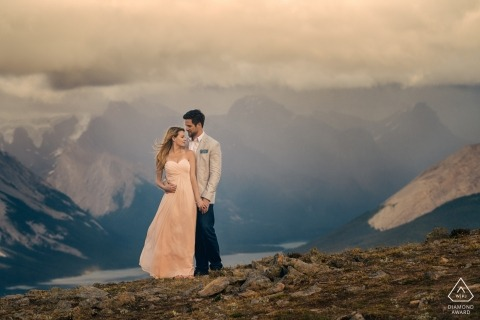 Jasper National Park, AB, Canada 	Mountains behind formal couple during portraits
