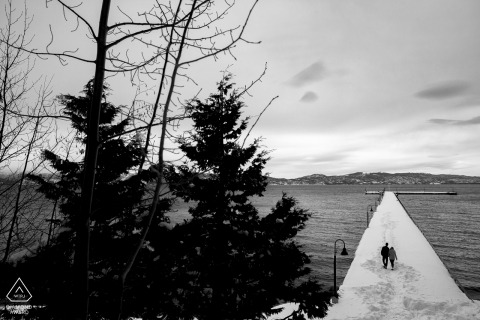 Tahoe City, Lake Tahoe engagement photo shoot   Walkin on the dock in deeps snow