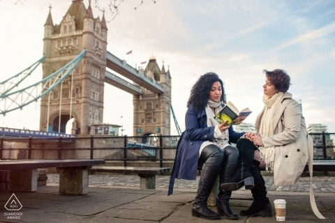 Tower Bridge, London engagement portrait | The activity this couples does the most is read to each other, so they wanted to have a shot of them reading during their engagement session