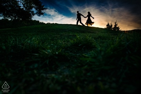 Pre wedding photography at Lenexa, KS - Engaged couple running together during sunset