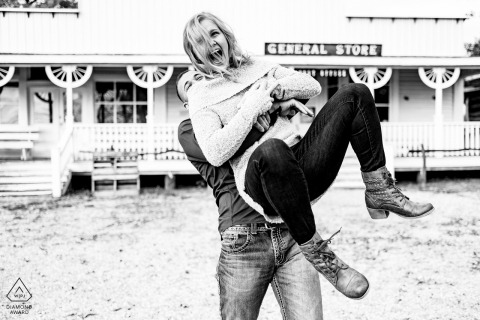 Kansas wedding engagment image in black and white | Merian, KS Engaged couple playing together